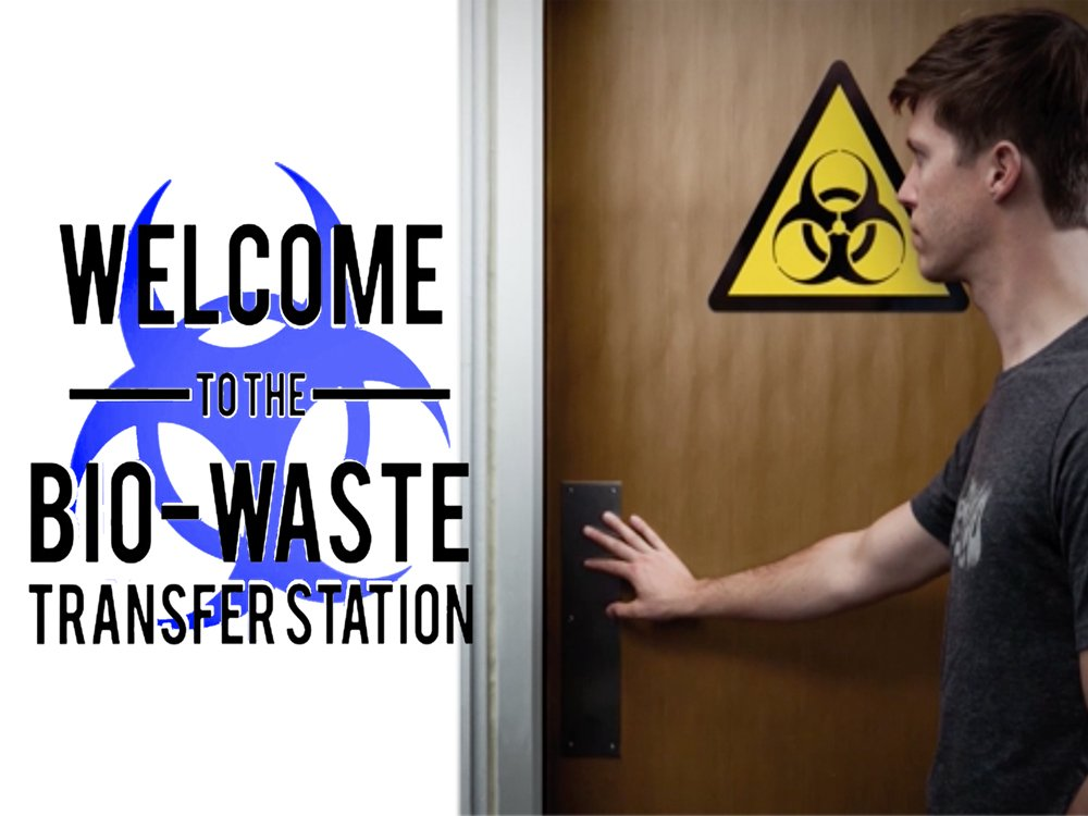 "Person entering restroom with warning ""Bio-waste transfer station"""